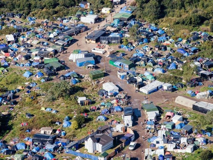 "Refugee camp in Calais ""Jungle"" Source: Independent"