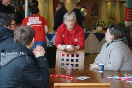 Brain tumour charity volunteers talking to families